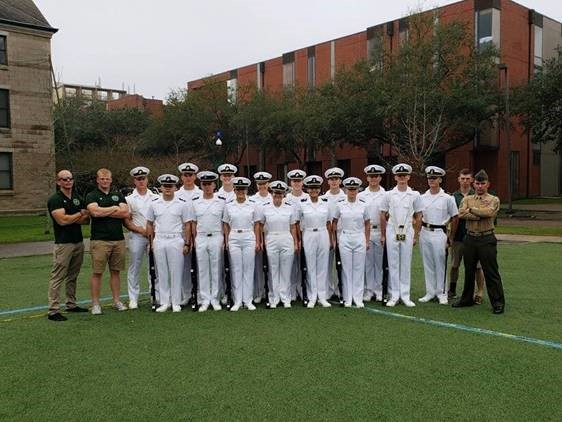 ROTC students on a lawn standing for a picture